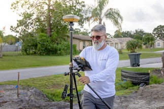 Florida land surveyor taps GPS/Robotic solution to keep crew size down, production up.