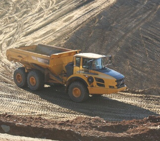 New technology monitors haul trucks' productivity on Virginia dam reconstruction.