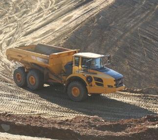 New technology monitors haul trucks' productivity on Virginia dam reconstruction.