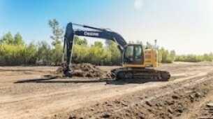 Nuovo sistema automatico per escavatore Topcon con comandi a sfioramento